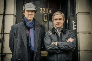 Benedict Cumberbatch and Martin Freeman as Sherlock Holmes wearing deerstalker and Dr John Watson outside 221 B Baker Street in BBC Sherlock Season 3